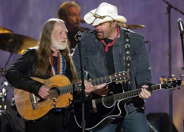 Willie Nelson, left, joins Toby Keith as they sing Beer for My Horses during the 38th annual Academy of Country Music Awards in Las Vegas, Wednesday, May 21, 2003. Photo: JOE CAVARETTA, AP / AP