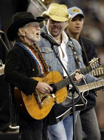 Willie Nelson and Toby Keith perform Sunday evening Feb. 1, 2004 during the pregame entertainment of Super Bowl XXXVIII between the Carolina Panthers and the New England Patriots. Photo: Kevin Fujii, Hearst Newspapers / Houston Chronicle