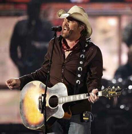In this April 3, 2011 file photo, country singer Toby Keith performs at the 46th Annual Academy of Country Music Awards in Las Vegas. Keith has had his gall bladder removed and was forced to reschedule his Aug. 2, 2012 show at Fort McCoy in Sparta, Wis. That concert date has been rescheduled to Aug. 30. (AP Photo/Julie Jacobson, file) Photo: Julie Jacobson, Associated Press / AP