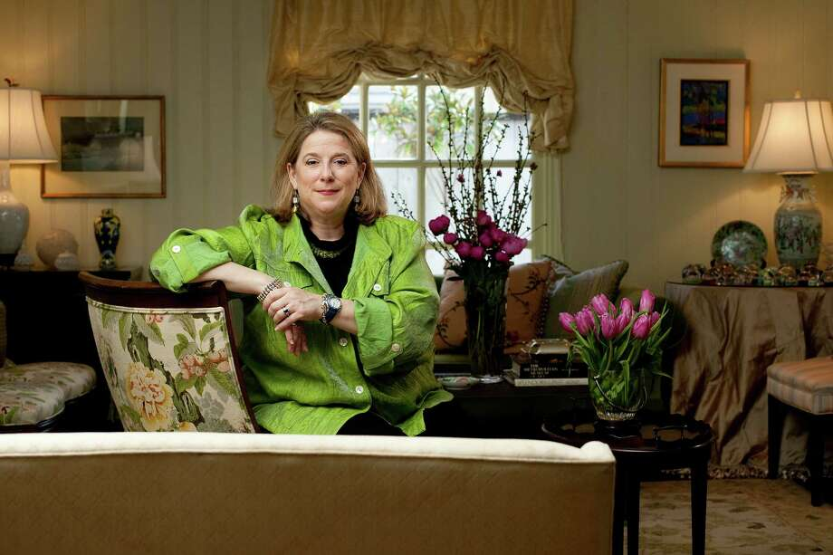 "Elizabeth Stone, at her home, has more than 20 years experience as a caterer and event planner. She also has a new cookbook out, ""An Invitation to Entertain."" Photo: Johnny Hanson, Staff / © 2013  Houston Chronicle"