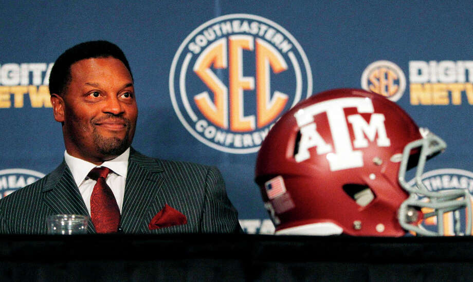 FILE - In this July 17, 2012, file photo, Texas A&M coach Kevin Sumlin smiles during a news conference at the NCAA college football Southeastern Conference media day in Hoover, Ala. Sumlin said Johnny Manziel will start Texas A&M's opener against Louisiana Tech on Aug. 30 as the Aggies prepare for their first season in the Southeastern Conference. (AP Photo/Butch Dill, File) Photo: Butch Dill, Associated Press / FR111446 AP