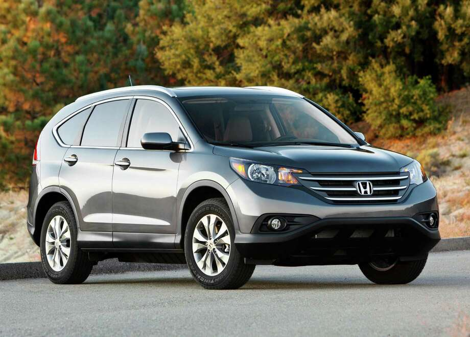 "Compact SUV/Crossover: 2005-2010 Honda CR-VWhat Edmunds said: ""Space-efficient, fuel-efficient and easy to drive and own, the Honda CR-V does almost everything well.""Source: Edmunds Photo: Honda, . / 2011 American Honda Motor Co.,"
