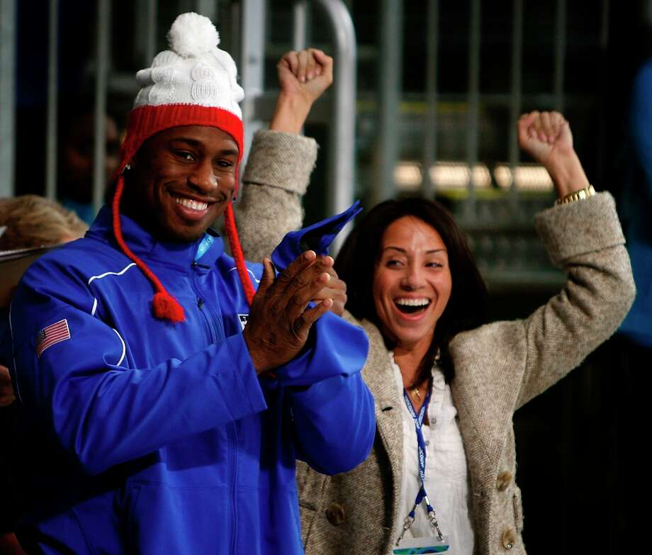 San Francisco 49ers tight end and honorary captain of the United States curling team Vernon Davis and his assistant Sasha Taylor cheer after the Americans beat France, 4-3, at the Winter Olympic Games in Vancouver, British Columbia, on Friday, Feb. 19, 2010.Paul Chinn/Chronicle Olympic Bureau Photo: Paul Chinn, The Chronicle / SFC