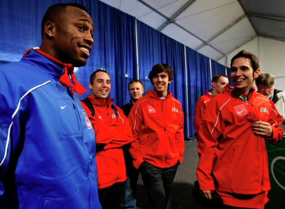 San Francisco 49ers tight end Vernon Davis meets with the United States curling team after the Americans beat France, 4-3, at the Winter Olympic Games in Vancouver, British Columbia, on Friday, Feb. 19, 2010.Paul Chinn/Chronicle Olympic Bureau Photo: Paul Chinn, The Chronicle / SFC