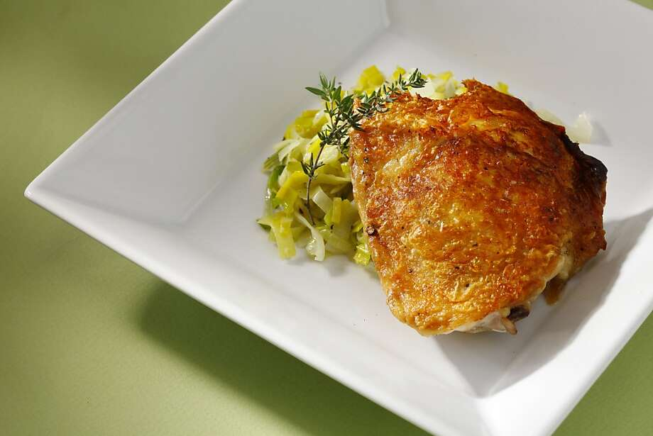 Pan-roasted chicken thighs with salt and pepper and buttered leeks are noticeably juicier and packed with more flavor than a boneless, skinless breast. Photo: Craig Lee, Special To The Chronicle