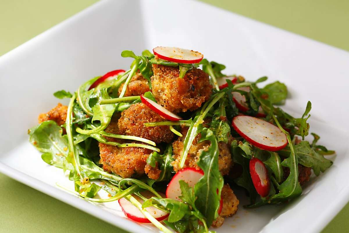 Crispy sweetbread nuggets, arugula & radish salad as seen in San Francisco, California, on Wednesday, January 9, 2013. Food styled by Simon F. F. Young.