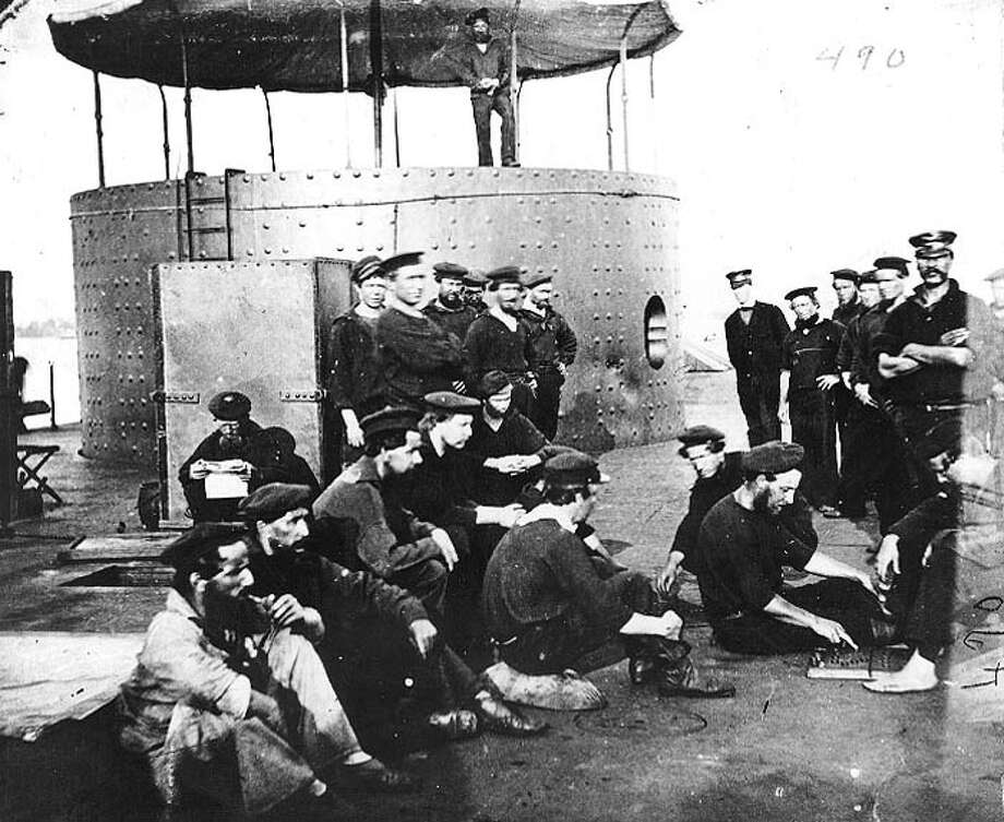 The USS Monitor was a 987-ton armored turret gunboat commissioned on Feb. 25, 1862. This isn't the best view of the Monitor, but is notable for showing crew members relaxing on deck. Note the gun turret. Photo: U.S. Naval History & Heritage Command