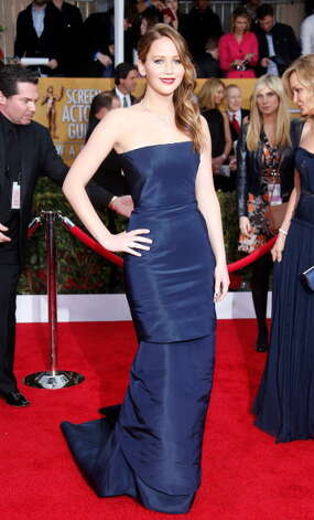 Jennifer Lawrence arrives at the 19th Annual Screen Actors Guild Awards in Christian Dior Couture at the Shrine Auditorium on January 27, 2013 in Los Angeles, California. Photo: Dan MacMedan, WireImage / 2013 Dan MacMedan