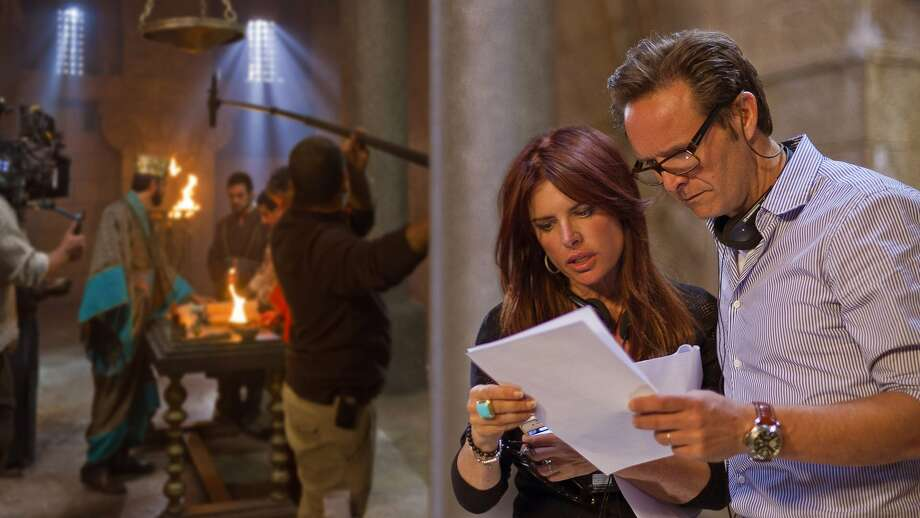 Roma Downey and Mark Burnett work behind the scenes during filming. Photo: History Channel
