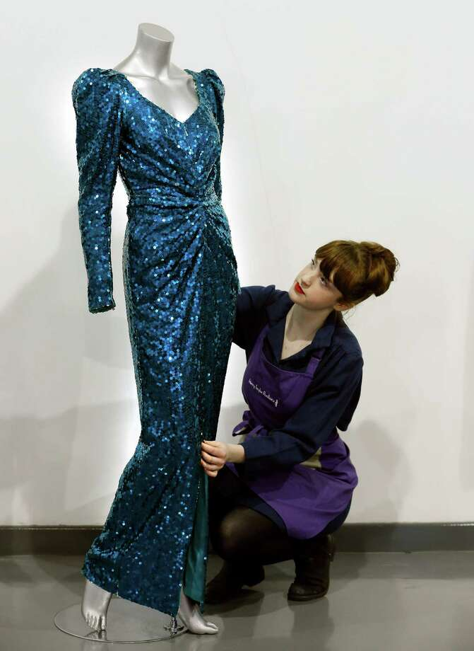 A Catherine Walker sea-green sequined evening gown worn for the State visit to Austria by Britain's Princess Diana. The dress is estimated to bring in $46,000-77,000. Photo: Kirsty Wigglesworth