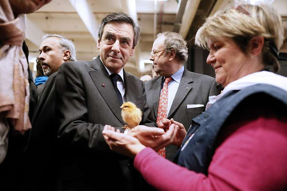 A bird in hand: Former French prime minister François Fillon meets some peeps at the Paris International Agriculture Fair. Photo: Kenzo Tribouillard, AFP/Getty Images