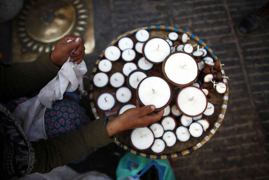 If you're out of clarified yak butter, vegetable oil will do: A vendor arranges her butter lamps at Swayambhunath stupa, an ancient religious complex atop a hill in Katmandu. The lamps, which traditionally burn clarified yak butter, supposedly help focus the mind and aid meditation. Photo: Niranjan Shrestha, Associated Press
