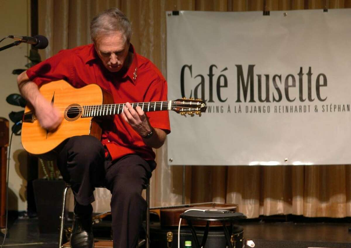 Cafe Musette performs during First Night festivities in downtown Westport on Thursday Dec. 31, 2009. Cafe Musette is led by Larry Urbon, shown here.