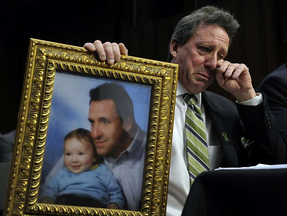 There are no words: Neil Heslin, the father of 6-year-old Jesse, who was slain in the Sandy Hook massacre in Newtown, Conn., wipes a tear away while testifying before a Senate panel about gun violence. Photo: Susan Walsh, Associated Press