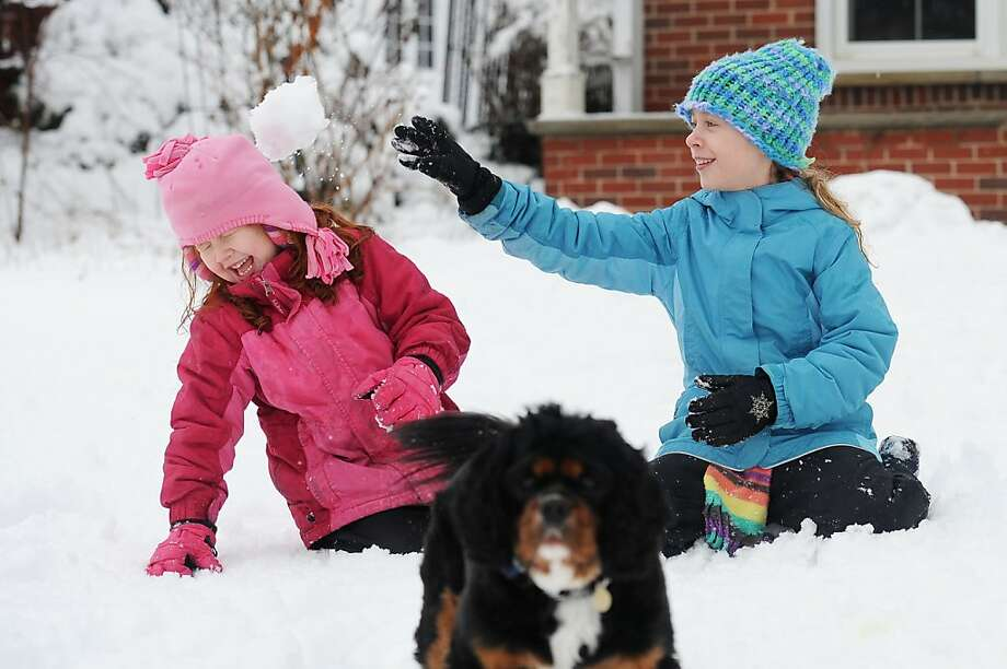 She's a good sport:Six-year-old Jaylee Oeschger laughs as big sister Ileana, 10, ambushes her at close range in Ann Arbor, Mich. Photo: Melanie Maxwell, Associated Press