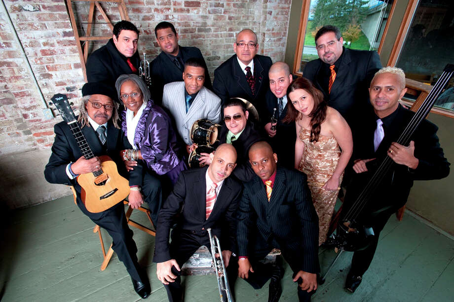 Juan De Marcos Gonzalez (far left, with guitar) will be bringing his band, the Afro-Cuban All-Stars, to the Palace Theater in Waterbury on Sunday, March 10. Photo: Contributed Photo