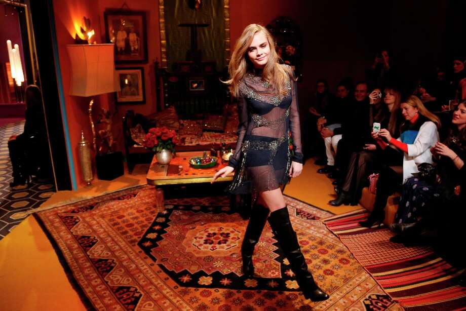 British model Cara Delevingne presents a creation for H&M during the Fall/Winter 2013-2014 ready-to-wear collection show, on February 27, 2013 at the Rodin Museum in Paris. Photo: FRANCOIS GUILLOT, AFP/Getty Images / 2013 AFP