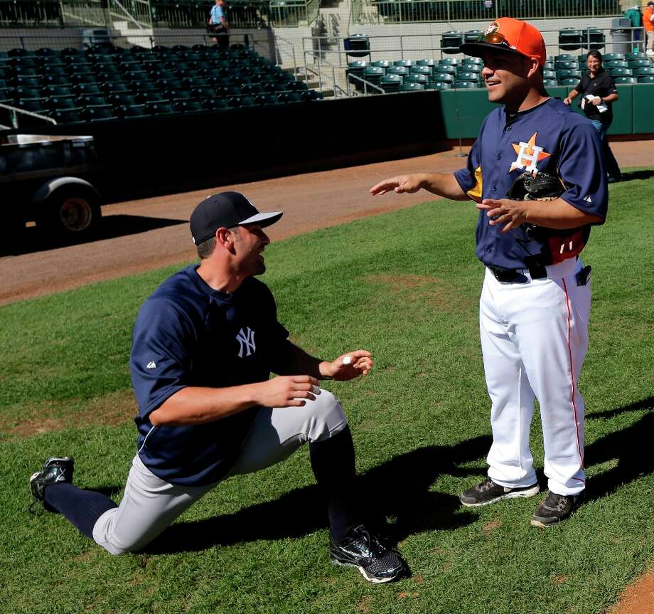 The Yankees' Francisco Cervelli, left, talks with Astros second baseman Jose Altuve, right, before the game. Photo: David J. Phillip