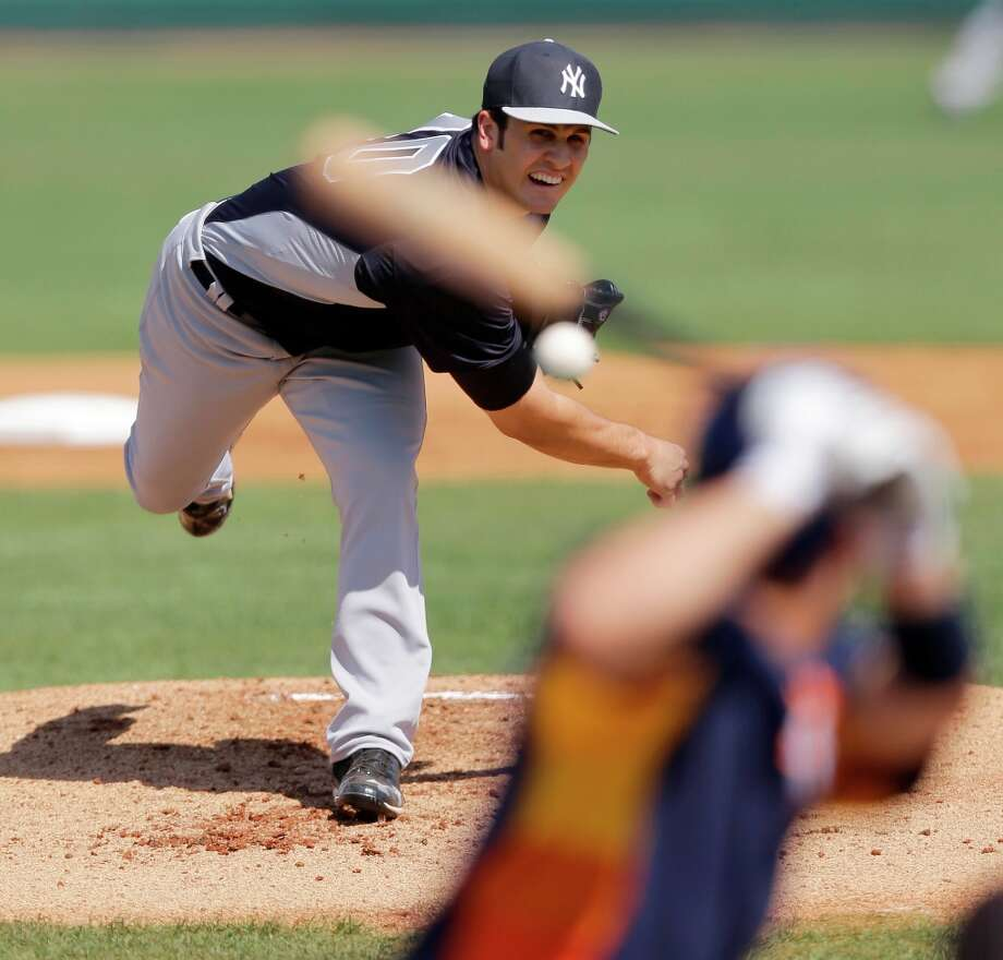 Yankees pitcher Brett Marshall throws to Jose Altuve during the first inning. Photo: David J. Phillip