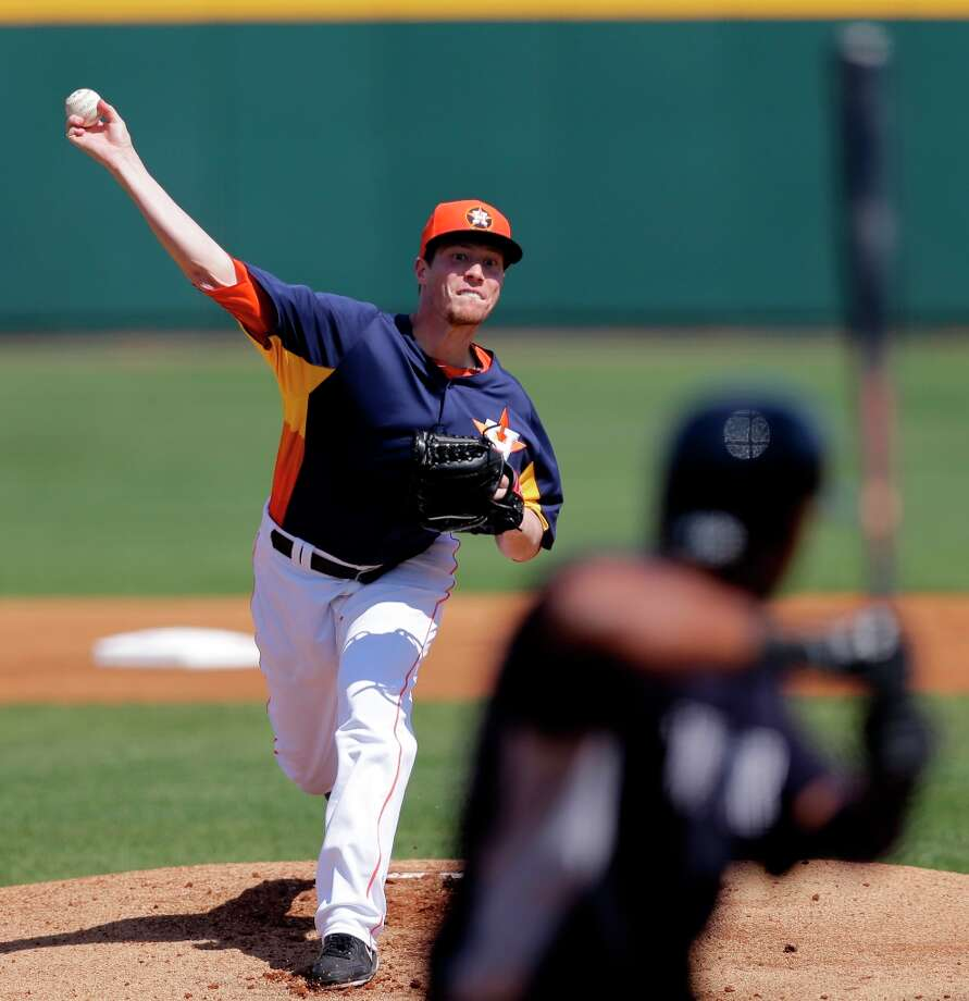 Astros pitcher Lucas Harrell throws to Eduardo Nunez during the first inning. Photo: David J. Phillip