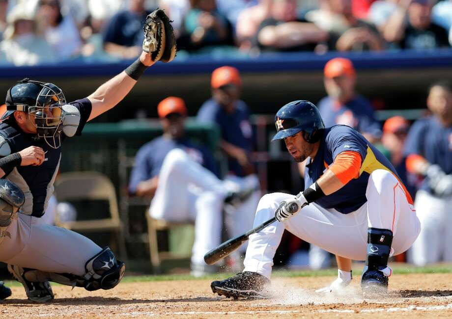 J.D. Martinez, right, falls to avoid a pitch as Yankees catcher Francisco Cervelli, left, handles the throw during the fourth inning. Photo: David J. Phillip