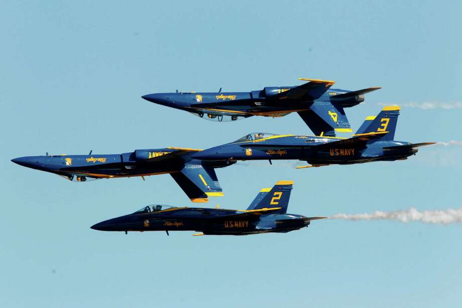 The U.S. Navy's Blue Angels perform at Wings Over Houston at Ellington Field in 2012. Federal budget problems are preventing the Blue Angels from flying for the rest of the fiscal year. (Mayra Beltran/Houston Chronicle) Photo: Mayra Beltran, Staff / © 2012 Houston Chronicle