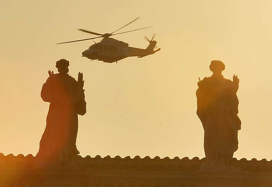 The helicopter carrying Pope Benedict to his temporary home at the papal summer retreat in Castel Gandolfo flies past St. Peter's Square after the pope left the Vatican for the final time. Photo: Alberto Pizzoli, AFP/Getty Images