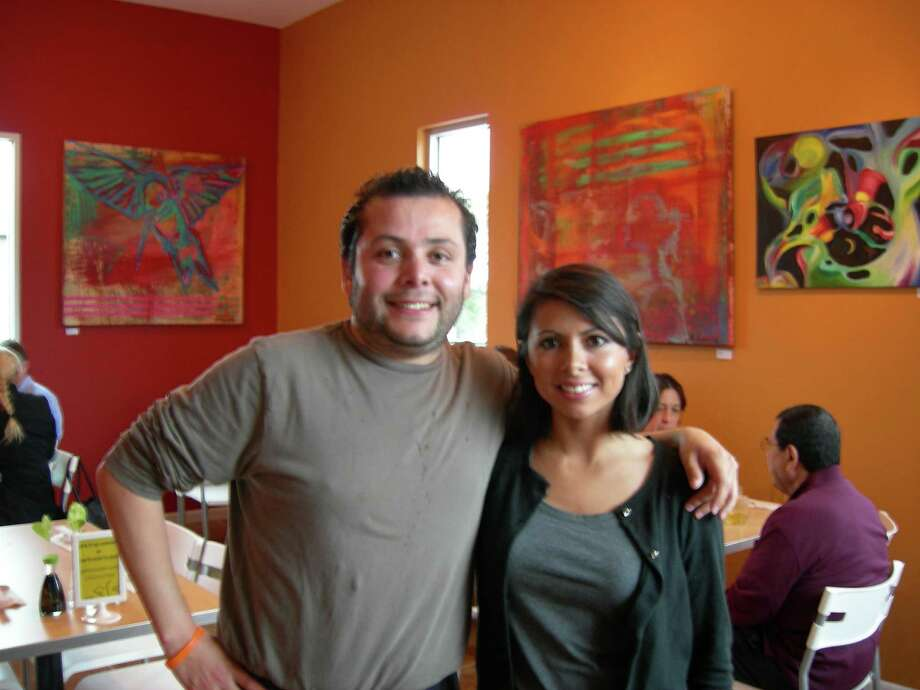 Siblings Alex and Brenda Sarmiento bring their love of sushi and environmentalism to yellowfish sushi. Photo: Stefanie Arias / San Antonio Express-News