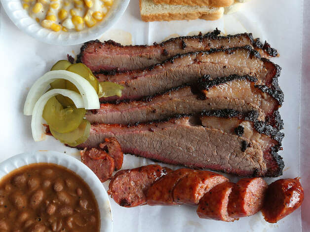 A well-seasoned crust on brisket is a thing of beauty. Here, it's part of a two-meat plate. Photo: Photos By Jerry Lara / San Antonio Express-News