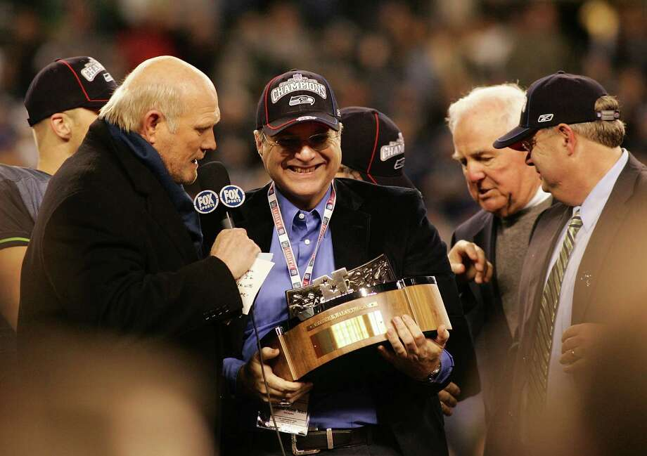 Paul Allen speaks with television commentator Terry Bradshaw and holds up the NFC Championship trophy following the Seattle Seahawks' victory on Jan. 22, 2006 in Seattle. Photo: Robert Giroux, / / 2006 Getty Images