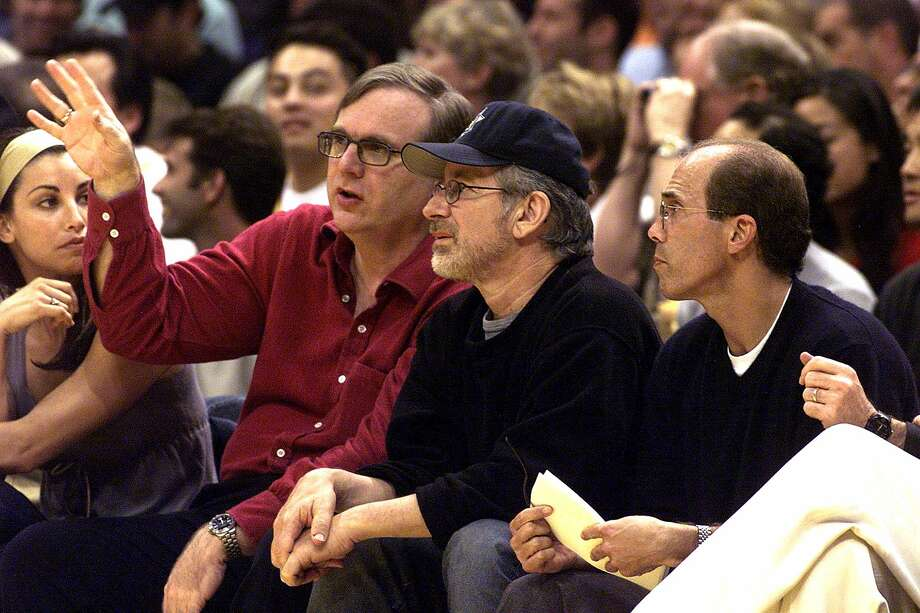 Portland Trail Blazer owner Paul Allen talks with DreamWorks owners director Steven Spielberg and Jeff Katzenberg during the 2000 NBA Western Conference Finals in Los Angeles. Photo: Vince Bucci, / / AFP