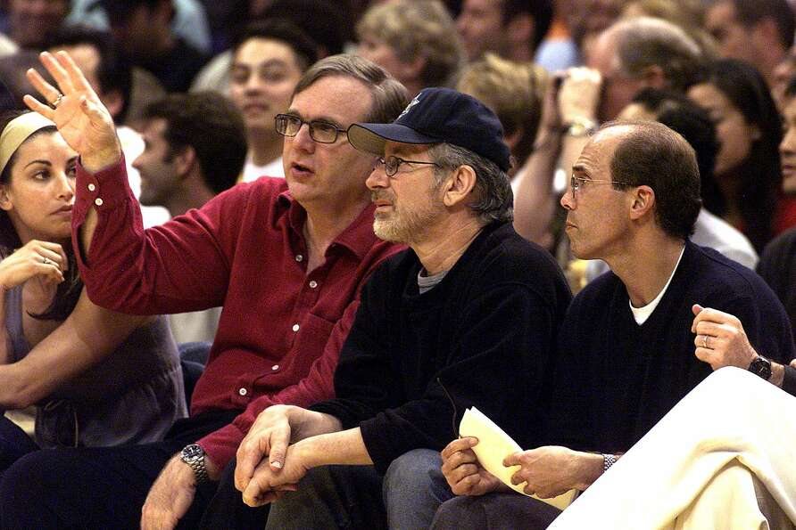 Portland Trail Blazer owner Paul Allen talks with DreamWorks owners director Steven Spielberg and Je
