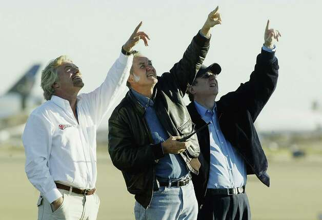 Sir Richard Branson, Burt Rutan and Paul Allen watch and point as SpaceShipOne circles the runway after it's successfull second voyage in a week to reach outer space in an attempt to win the $10 million ANSARI X PRIZE at the Mojave Airport Civilian Aerospace Test Center on Oct. 4, 2004 in Mojave, Calif. Photo: Pool, / / 2004 Getty Images