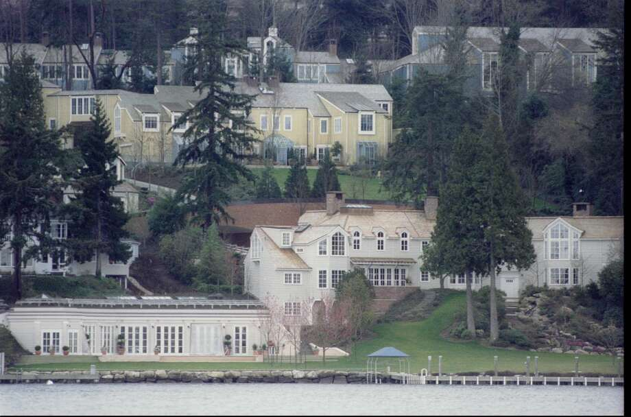 Paul Allen's Lake Washington residence, circa 1996. Among the buildings in the compound behind his residence are his mother's house and a $6 million sports complex. Facilities include a movie theater, two swimming pools, and several garages to housed his car collection which includes four Ferraris and a Lamborghini. Photo: JEFF LARSEN, /