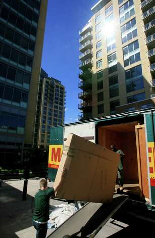 A new resident of 2200 Westlake is moved into the condo building in Seattle's South Lake Union neighborhood on June 25, 2007. The building was one of many projects developed by Vulcan. Photo: Dan DeLong, / / Seattle Post-Intelligencer