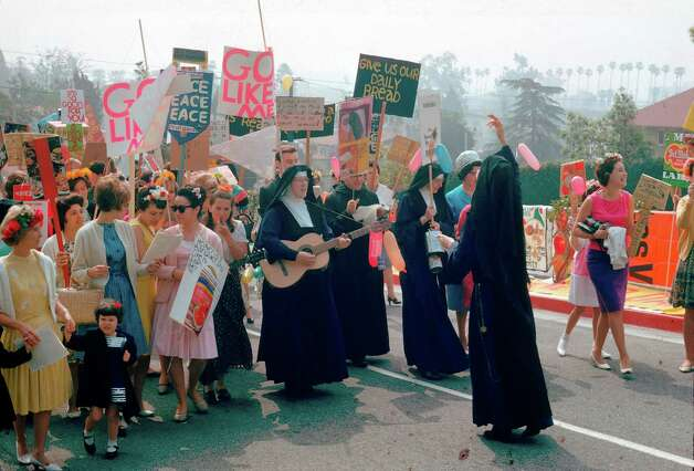 Corita Kent leading Mary's Day Parade, 1964, courtesy of Corita Art Center, Los Angeles
