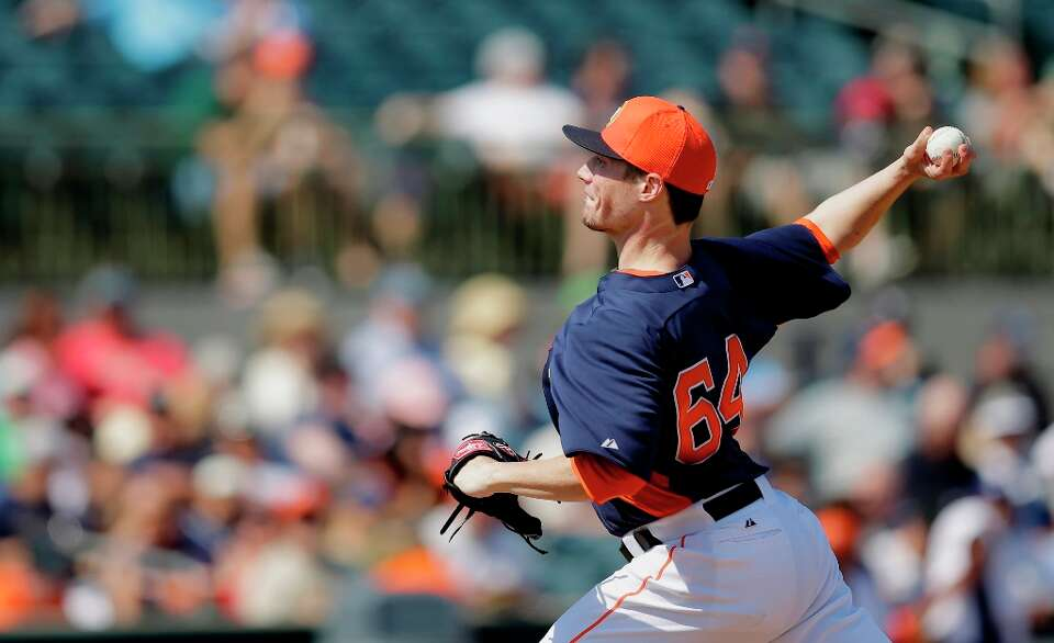 Astros pitcher Lucas Harrell throw against the Yankees during the third inning.
