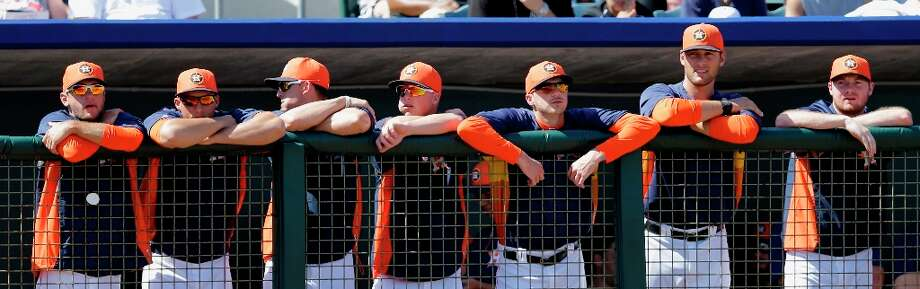 Members of the Astros watch from the dugout during the third inning. Photo: David J. Phillip