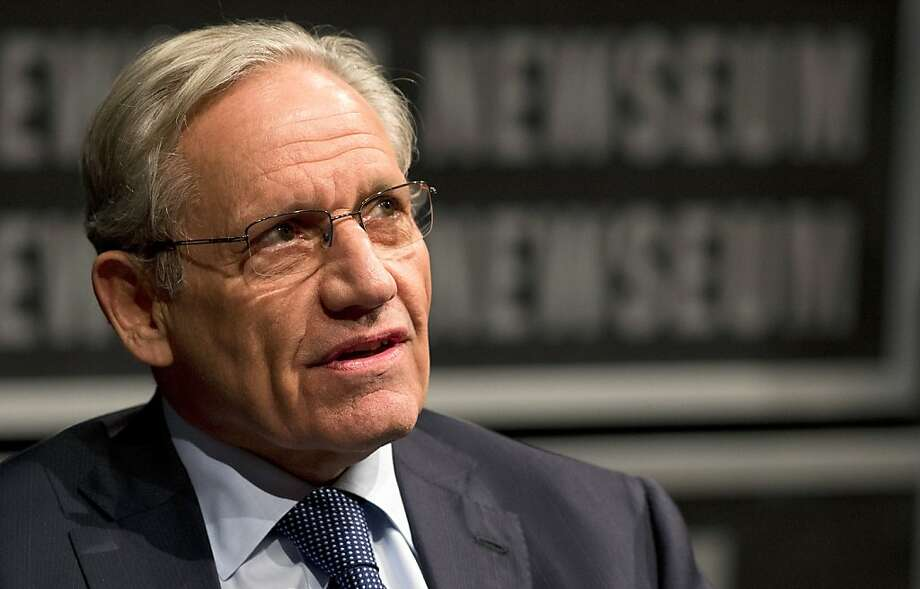 Reporter Bob Woodward and presidential aide Gene Sperling. Photo: Jim Watson, AFP/Getty Images