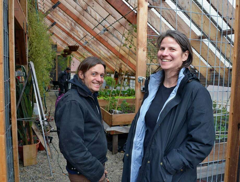 Scott Kellogg, left, and Stacy Pettigrew at the Radix ecological sustainability center greenhouse in Albany Tuesday Feb. 19, 2013.  (John Carl D'Annibale / Times Union) Photo: John Carl D'Annibale / 00021225A