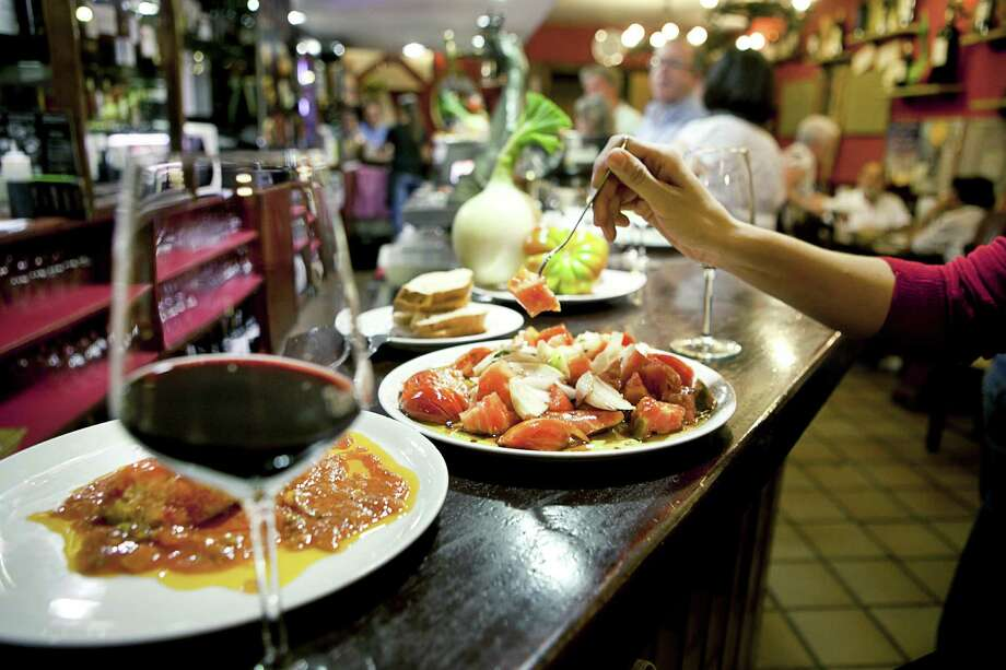¡Order up, por favor! A restaurant in Spain dishes up a variation of the Mediterranean diet. Nuts, olive oil, wine and fatty fish are key in diets in Spain, Italy and Greece, among others. Photo: James Rajotte, New York Times