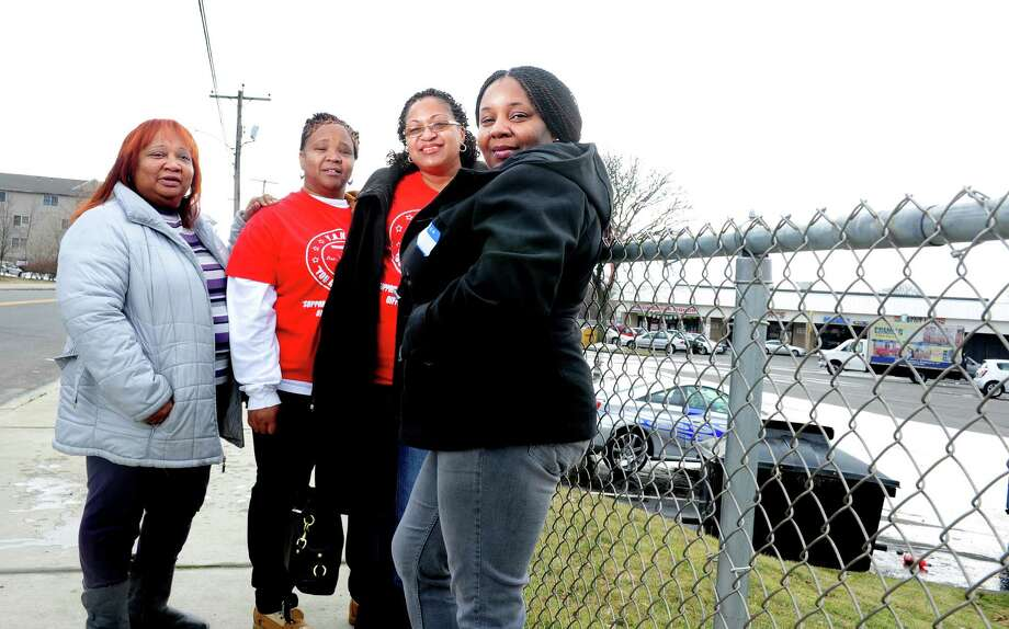 Members of You Are Not Alone (YANA), a support group for Bridgeport mothers who've lost a child to acts of violence, Teresa Russell, Dawn Spearman, Jacqueline Pettway and Nicole Matthews, from left, stand together Thursday, Feb. 28, 2013 near Boston Avenue in Bridgeport, Conn. Photo: Autumn Driscoll / Connecticut Post