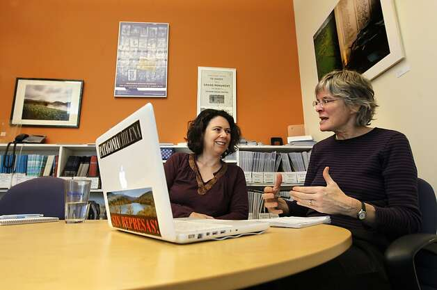 Aviva Imhof, campaigns director and Lori Pottinger, who runs the Africa program and is the editor of their newsletter work with a colleague in South Africa via Skype, at their offices in Berkeley, Calif., on Wednesday Feb. 28, 2013. The sticker on the back of the computer reads, Patagonia without dams. Berkeley non-profit International Rivers just won a MacArthur grant for its work around the world fighting dam projects in Asia, Africa, South American and the Middle East. Photo: Michael Macor, The Chronicle