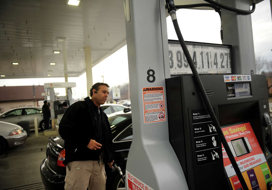 Fairfield Police Officer Jim Perez fills up his car at the Stop & Shop gas station at 705 Villa Avenue in Fairfield on Thursday, February 28, 2013. Regular gas is selling for $3.99 per gallon atthe station. Photo: Brian A. Pounds / Connecticut Post