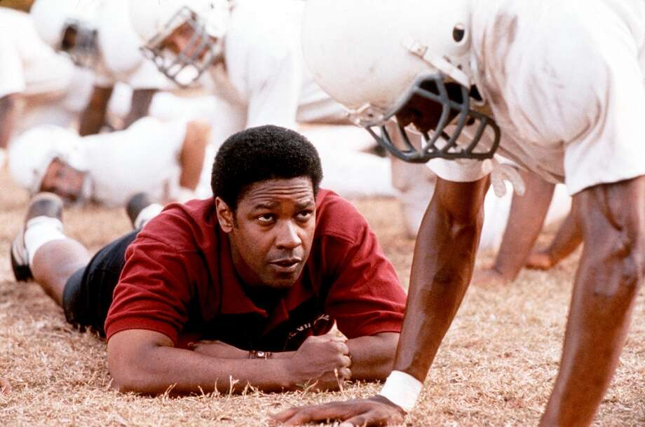 Denzel Washington starred as Coach Herman Boone in the 2000 film Remember The Titans. Photo: Getty Images / Getty Images North America