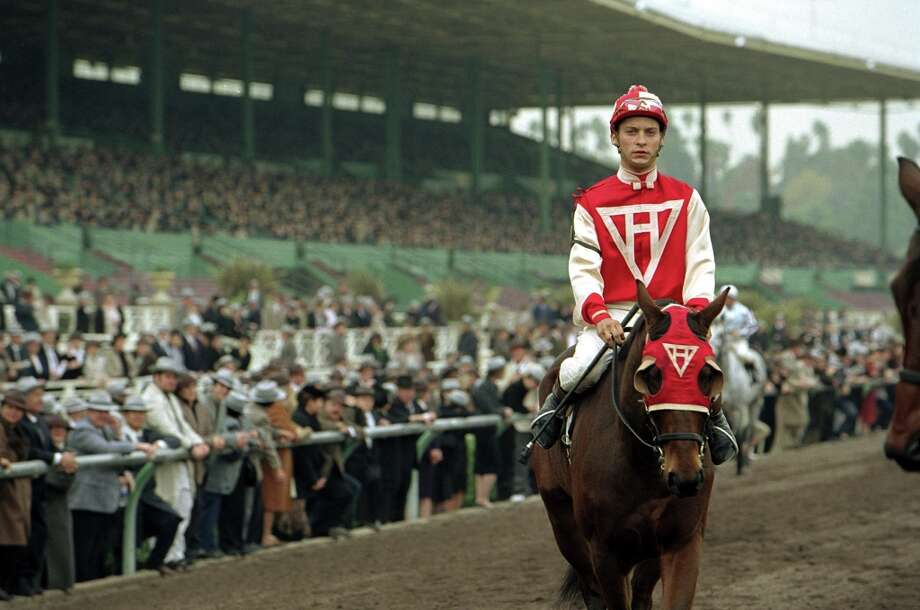 Tobey Maguire wears the red silks of Charles Howard in the 2004 horseracing movie Seabiscuit. Photo: HO / HO