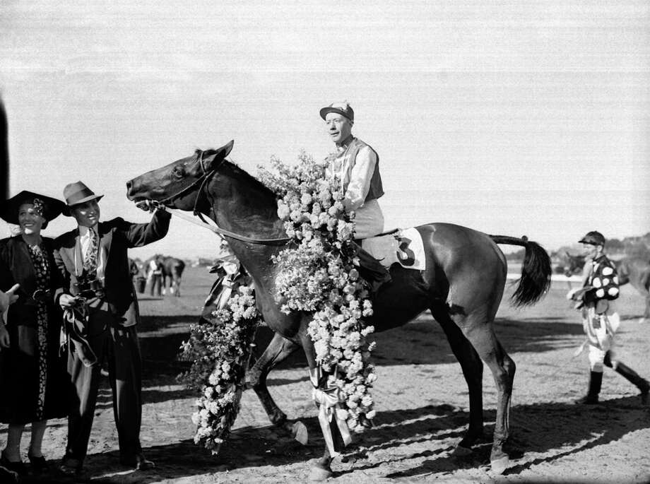 Maguire played real-life jockey Red Pollard seen here celebrating Seabiscuit's victory at Suffolk Downs in Boston on Aug. 7, 1937. Photo: HBR, Associated Press / AP