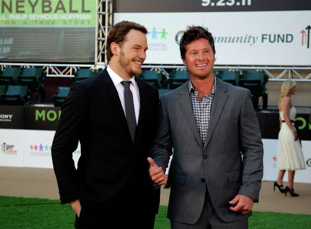 Actor Chris Pratt, left, and former Oakland Athletic Scott Hatteberg arrive at the Paramount Theatre of the Arts for the premiere screening of the movie Moneyball Monday, Sept. 19, 2011, in Oakland, Calif. Pratt portrayed Hatteberg in the film. Photo: Ben Margot, AP / AP