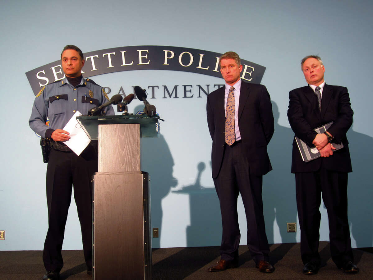 Deputy Chief Nick Metz, pictured on the left, with Assistant Chief Jim Pugel and then-Seattle Police Chief John Diaz in February 2013.