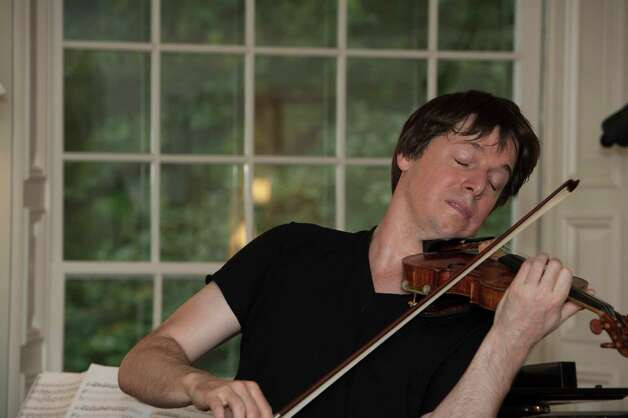 "Grammy-winning violinist Joshua Bell performed Vivaldi's ""Four Seasons"" with Frederic Chiu at a 2012 fundraiser for Beechwood Arts, a nonprofit organization that hosts cross-collabroative salon-style gatherings in Westport. Bell and Chiu's performance was interspersed with and influenced by live recitations of Vivaldi's accompanying sonnets by actor James Naughton and Fairfield High School student Rachel Rival. Photo: Katie Settel, Contributed Photo / Connecticut Post Contributed"